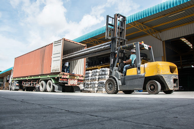 warehouse laborer team at unloading work