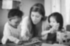 A speech therapist and two children at MouthWorks Speech Pathology in Hobart