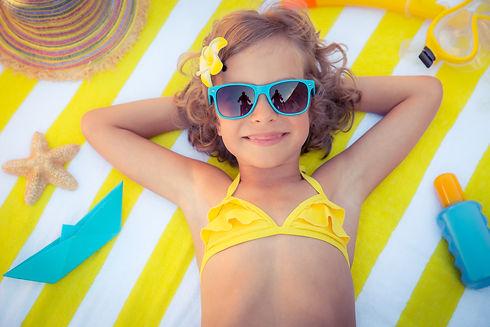 Happy child on the beach. Kid having fun