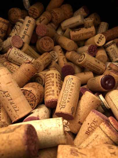 Corks aplenty... this becomes jewelry, trivets, and more.