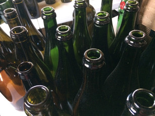 A batch of bottles cleaned and ready to be cut.