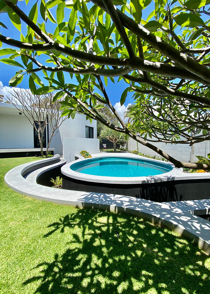 Raised pool and landscaping design with