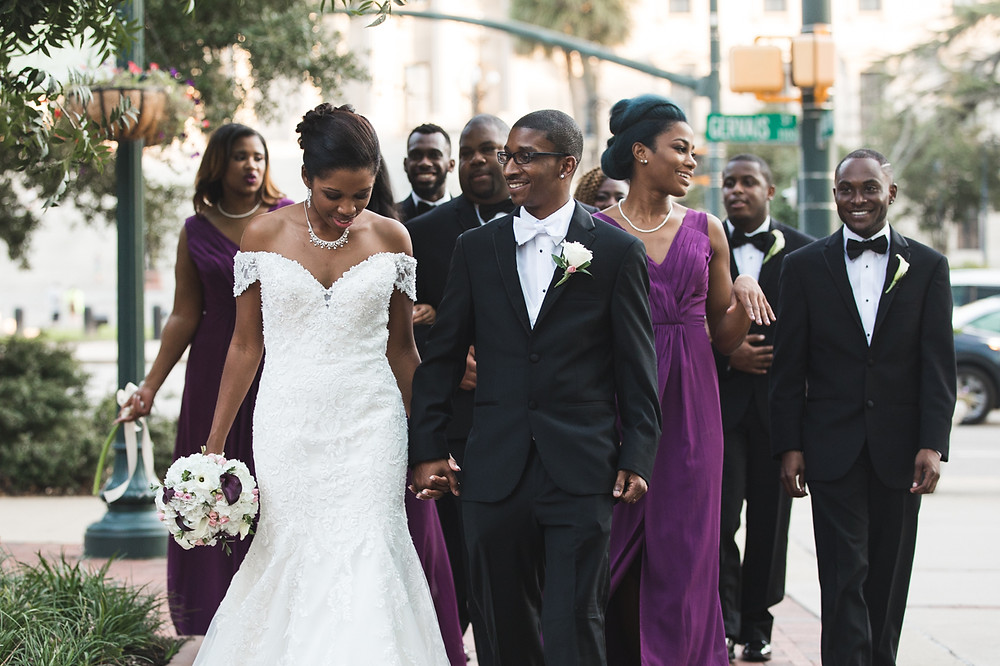 The bridal party walking downtown Columbia