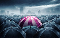 pink-and-white-umbrella-with-dark-stormy