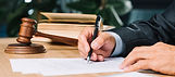 judge-holding-pen-checking-document-wood