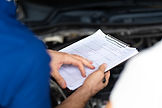 mechanic-man-and-woman-customer-check-th