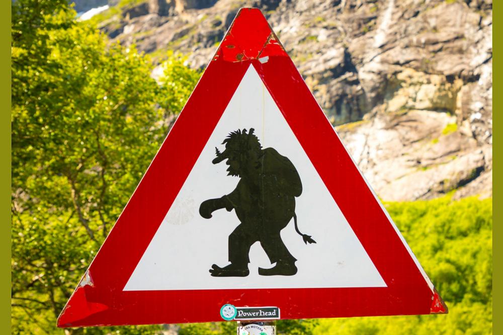 Street sign of a troll crossing a street