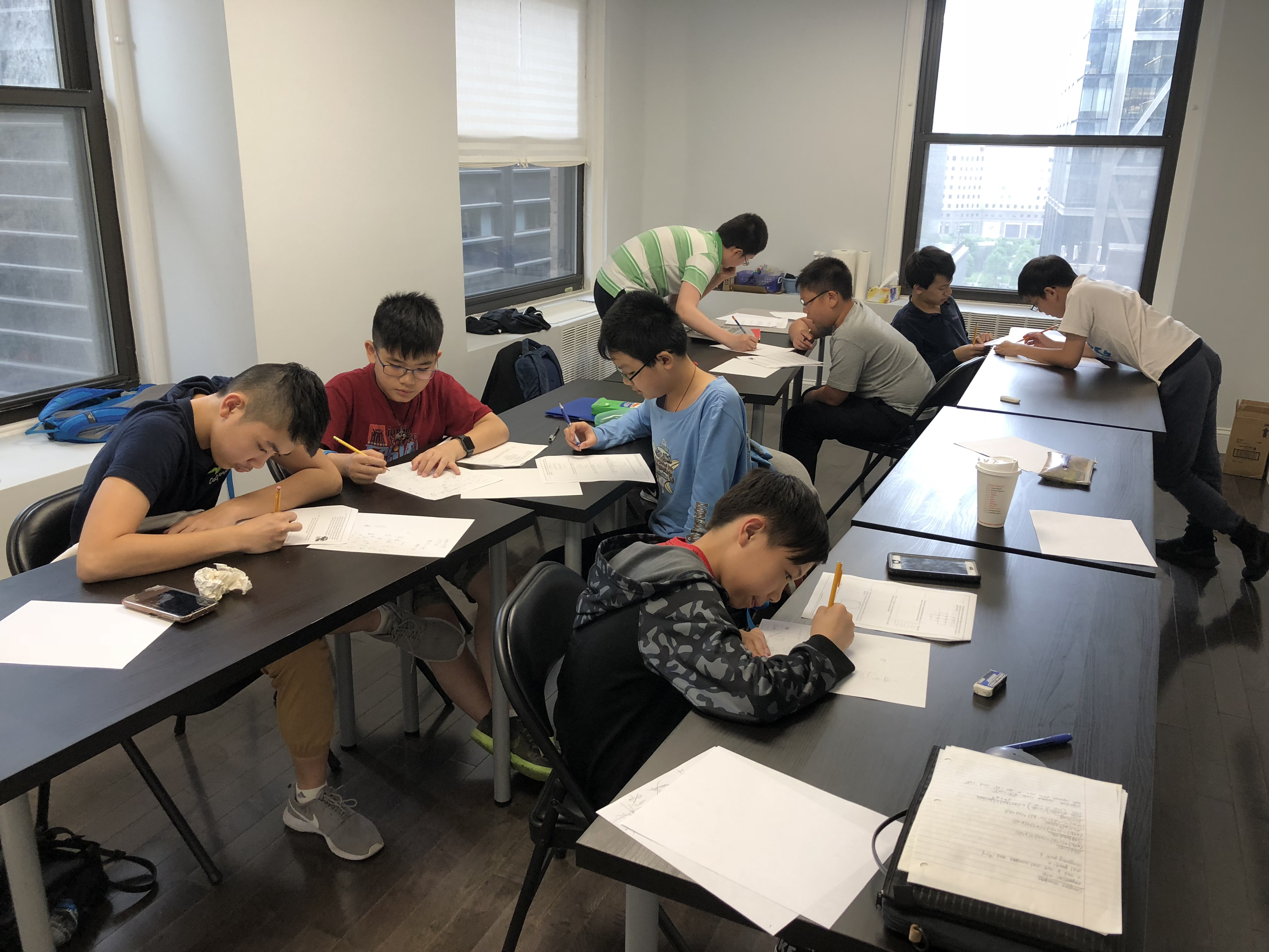 Students in Junior Math Olympiad A: Algebra Class Competing