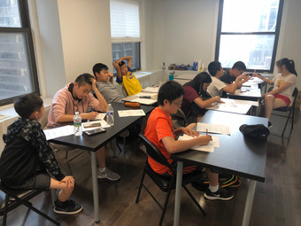 Students in Junior Math Olympiad B: Number Theory Class Competing in Teams