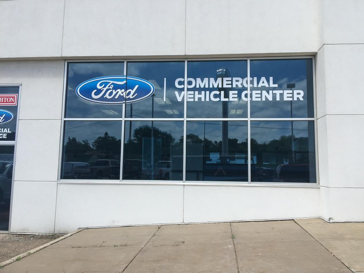 Cut Vinyl on Window of Ford Dealership