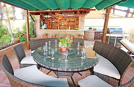 Pool bar with fridge freezer, sink, hot & cold filtered water, large outside dining area, bbq area and many sunbeds on patio.
