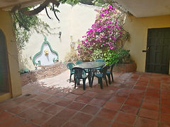 Beautiful and tranquil courtyard entrance to villa. Idea for breakfast