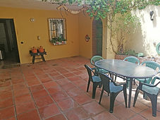 Courtyard leads to utility room with sink, Washing machine and tumble drier and dartboard.