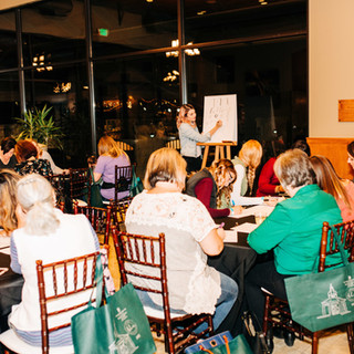 shoppers at a calligraphy workshop offered by selah creative studio at boerne handmade market