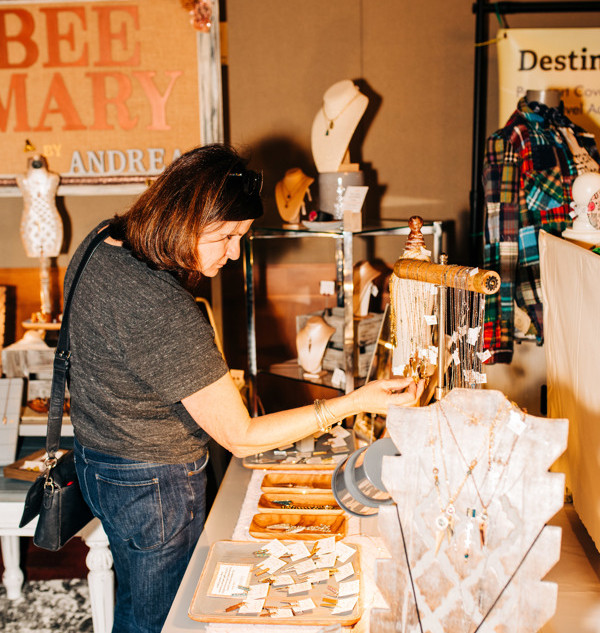 shoppers viewing vendor products at boerne handmade market