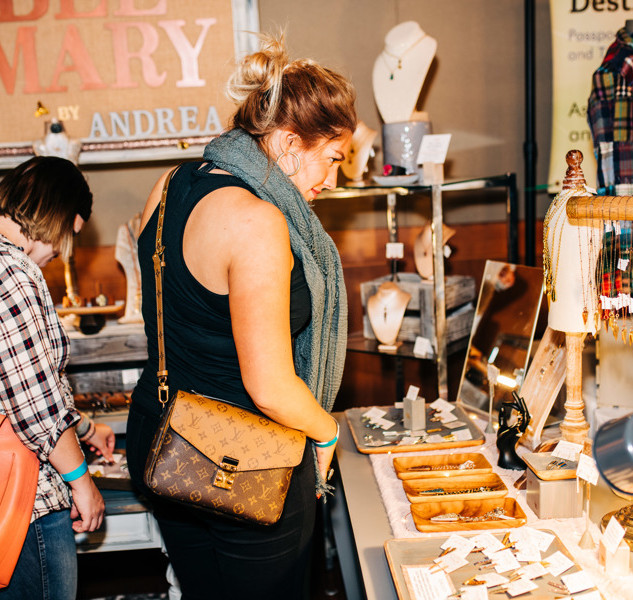 shoppers viewing jewelry from vendor bee mary at boerne handmade market