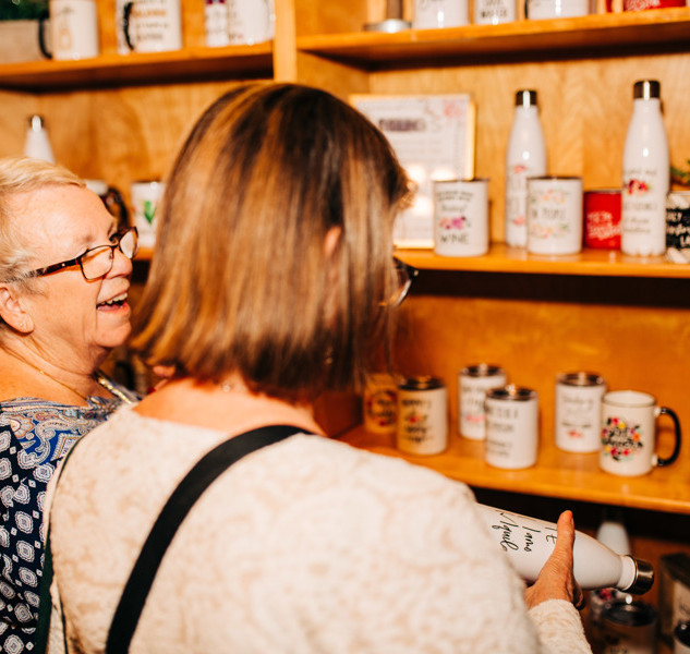 shoppers viewing mugs and cups at boerne handmade market