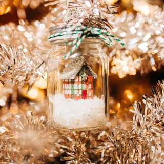 glass jar christmas ornament with snow and tiny house available for purchase at boerne handmade market