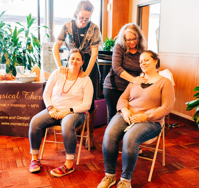 shoppers receive mini chair massages from monarch physical therapy at boerne handmade market vip night
