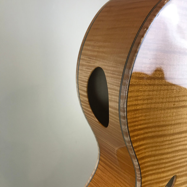 Curly maple binding