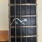 Abalone and Pearl inlay at 12th fret
