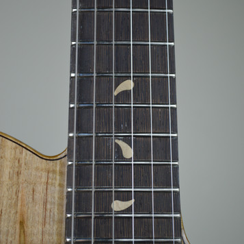 "Maple ""Water Drop"" inlays"
