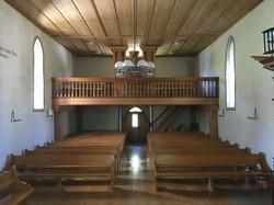 Interior with pipe organ Elm