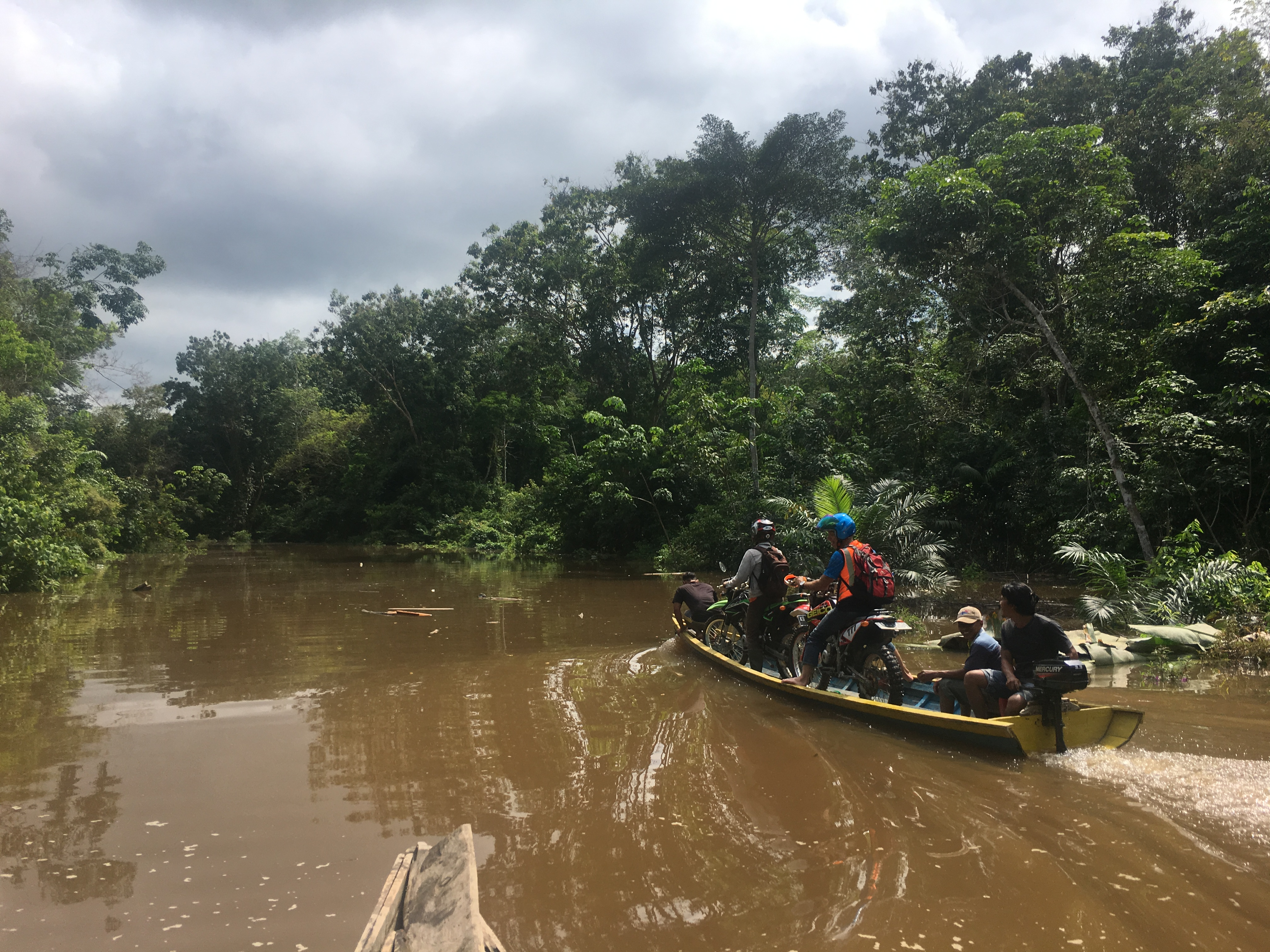 Flooded roads means using canoes