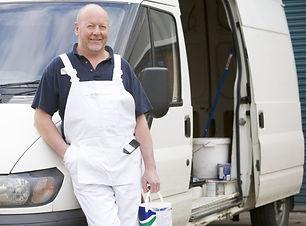 Decorator Standing Next To White Van.jpg