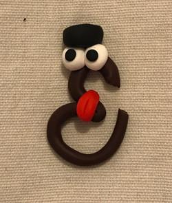 Arabic figurine clay sculpture art calligraphy googly eyes