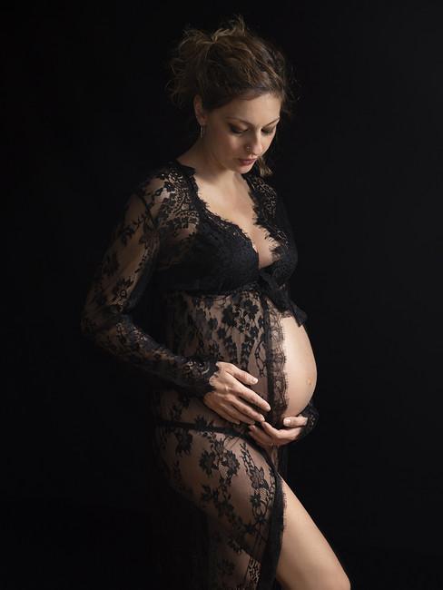 A colour maternity portrait in black