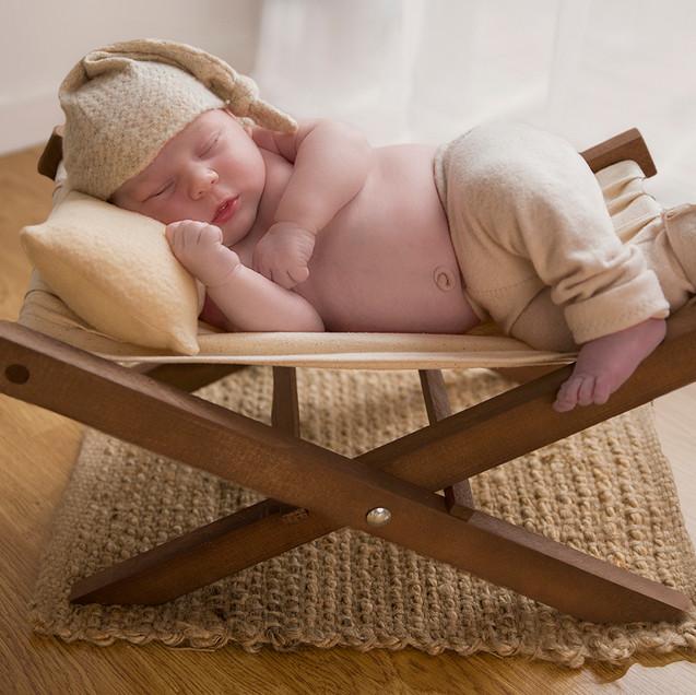 Baby boy chilling on deckchair