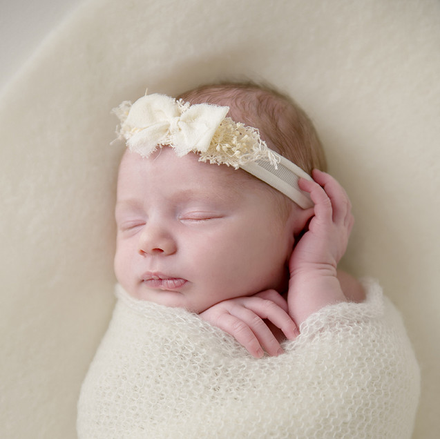 Wrapped baby girl with flower headband