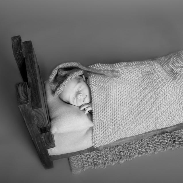 Baby Boy sound a sleep on rustic bed