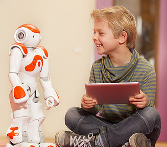 Young child playing with humanoid robot