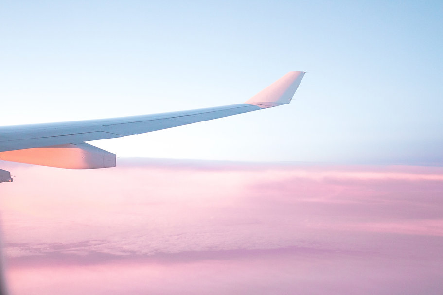 pink clouds plane wing travel_edited.jpg