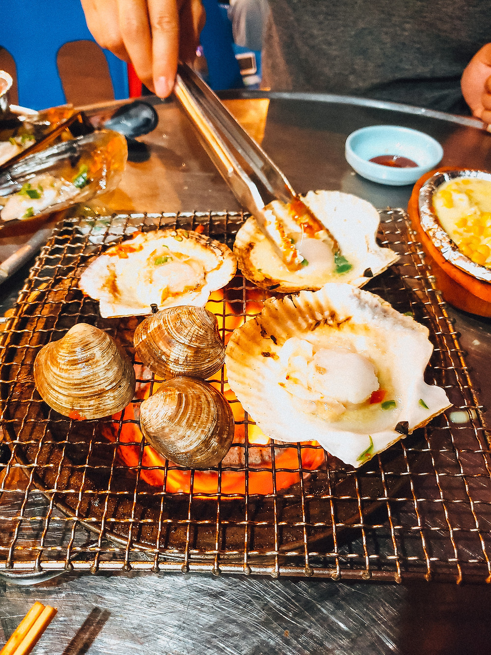 charcoal grill fresh scallops clams beach busan