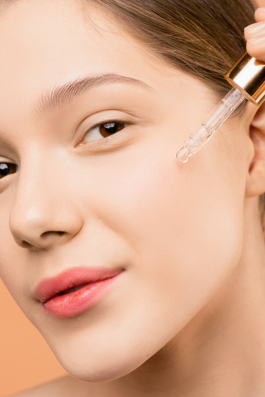 face serum woman pink lipstick