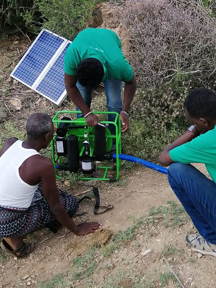 Solar pump being installed.JPG
