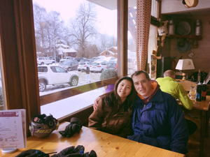 father and daughter in a little ski cafe
