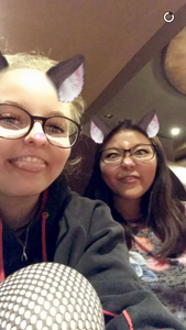 Two girls using a snapchat filter