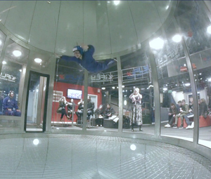 Girls floating solo in iFly Indoor skydiving wind tunnel