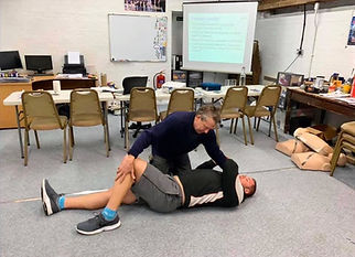 First aid trainer demonstrates the recovery position