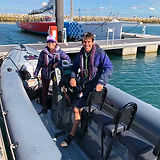 Two people on a training boat