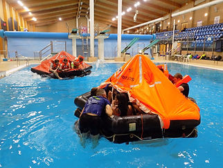 Offshore survival training pool with life rafts