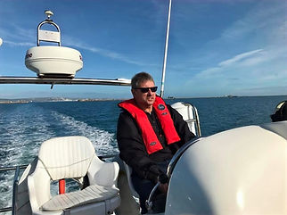 Skipper at the wheel of a boat