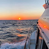 Boat at sea at sunset