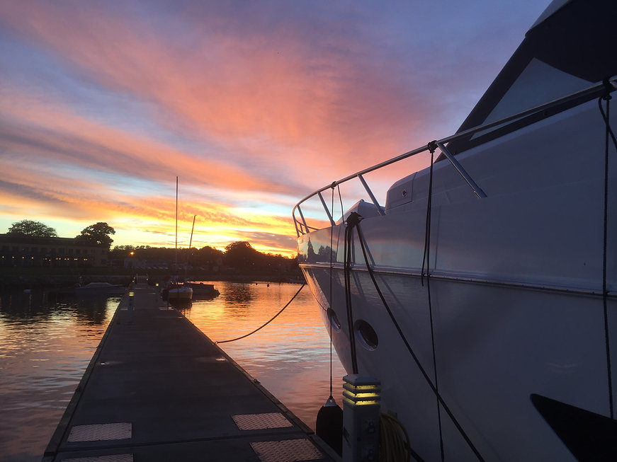 Image of a boat at a dock at sunset