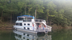 Houseboat anchored at shore