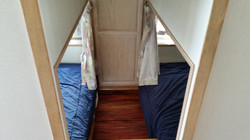 Two queen beds in galley.